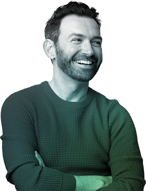 Man in sweater laughing